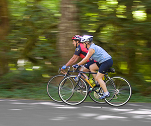 Two bicyclists on a wooded path at Wildwood Recreation Site in Welches