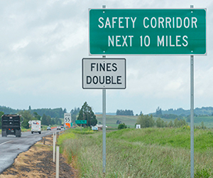 Sign on highway: Safety Corridor Next 10 Miles, Fines Double