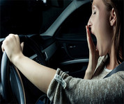 Driver yawning behind the wheel