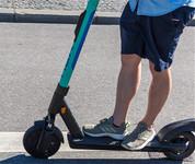 Person riding e-scooter