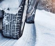 Closeup of winter tires on snowy road