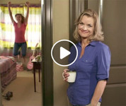 Video: Mom smiling and standing in doorway. Teen jumping for joy.
