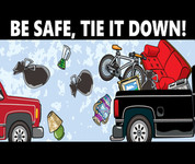 Secure your load. Be safe, tie it down! Image: pickup with household items flying out the back.