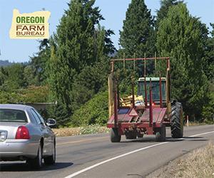 Oregon Farm Bureau logo. Image: vehicle following tractor on highway