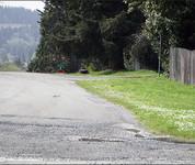 Roadway in Powers, Oregon without sidewalks