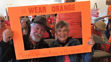 Senator Riley and Katie Riley pose for a framed photo dressed in their Orange to support ending gun violence.