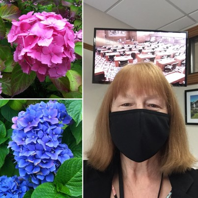 Susan in a mask, and flowers