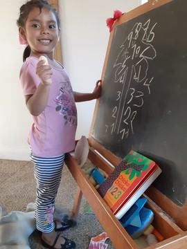 Maria at chalkboard
