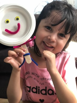 Maria shows off her social-emotional learning feelings project