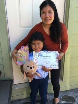Jennifer and her mom hold end-of-summer certificate