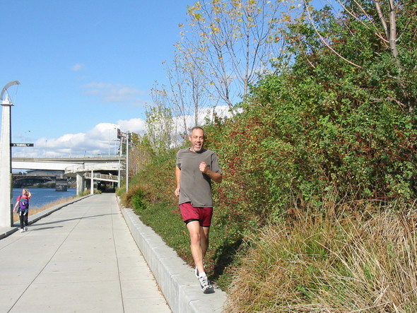 Eastbank Esplanade jogger with native plants