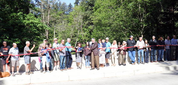 cutting the ribbon on the 122nd Avenue bridge