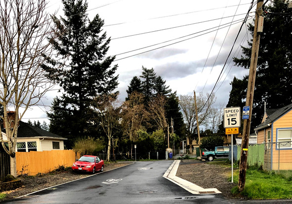 newly paved street on NE Holladay between 118th and 119th as part of the HOP Greenway