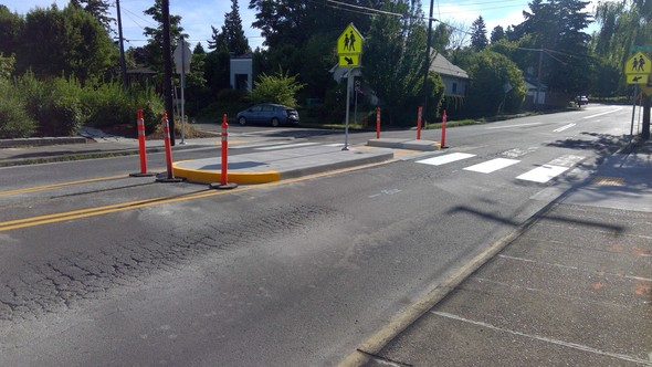 The median and updated curb ramps at SE 29th and Holgate creates a safer crossing for students at Grout Elementary and Tucker Maxon School