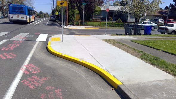 The curb extension and larger median at NE Killingsworth and NE 52nd