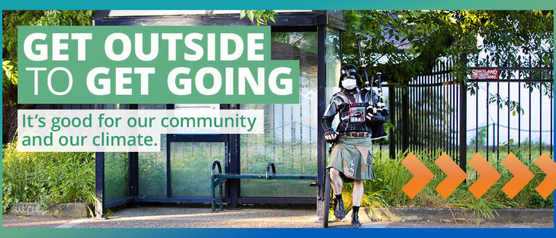 Get Outside to Get Going - It's good for our community and our climate. Photo shows the Unipiper standing next to a TriMet bus stop.