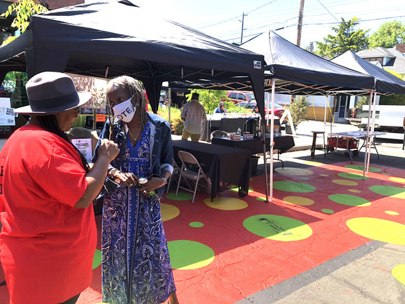 Commissioner Jo Ann Hardesty speaks with a community member at the Dream Street Plaza grand re-opening on May 15, 2021. Photo by PBOT.