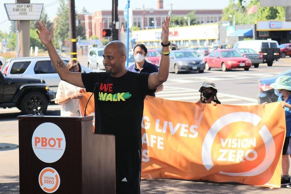 Oregon Walks Director Ashton Simpson speaks at the 82nd Avenue press event.