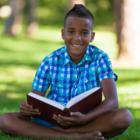 summer reading boy on lawn