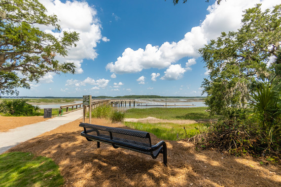 Photo of a park bench overlooking Skull Creek at the Rowing and Sailing Center at Squire Pope Community Park