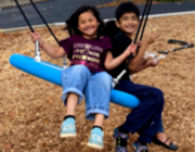 two children on a swing