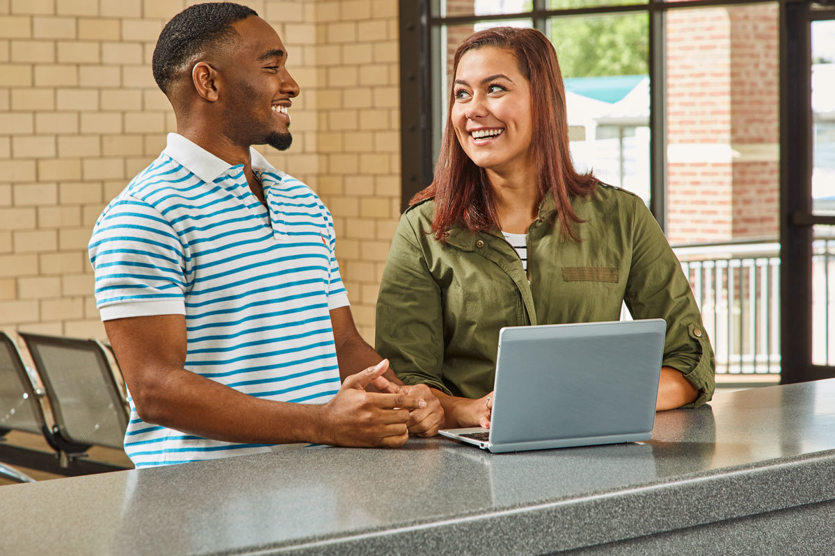 Man and woman at a desktop computer