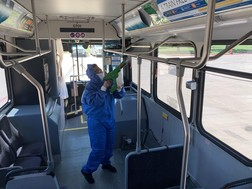 DCTA Personnel Cleaning a Bus