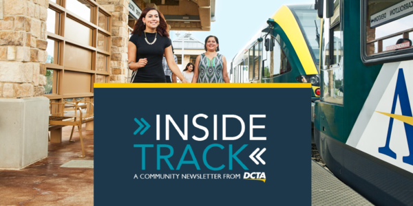 Passengers boarding train. Inside Track Logo at bottom of image