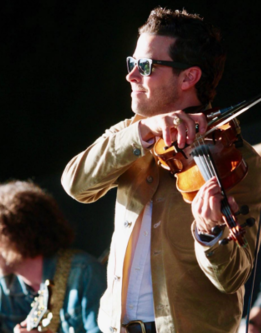 photo of Brendon playing fiddle