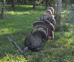 Boy with his first turkey