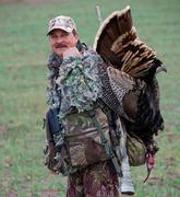 turkey over smiling hunter's shoulder