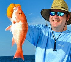 red snapper held by angler in hat