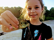 Young girl holding fish