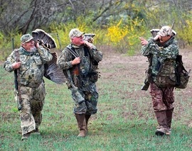 3 turkey hunters with birds on their back