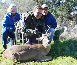man in wheelchair with buck and mentor