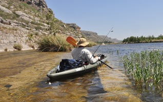 angler in kayak on Devils River