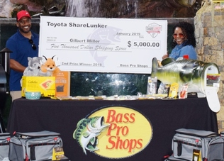 Gilbert Miller and wife with $5,000 shopping spree at Bass Pro Shops