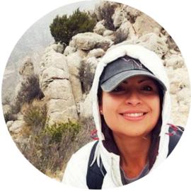 Female volunteer selfie in front of mountains