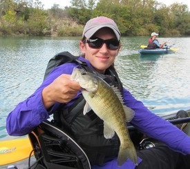 female angler holding Guadalupe bass