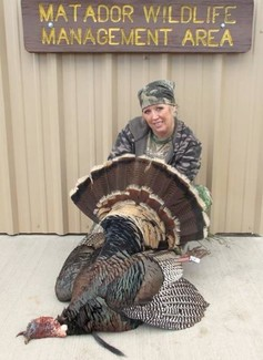woman with harvested turkey at Matador WMA