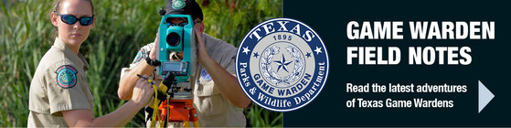 2 Game Wardens with a camera, link to Field Notes