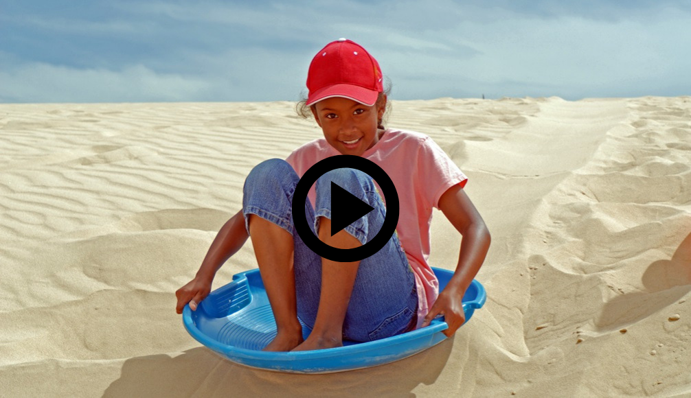 Girls sliding down a dune at Monahans, video link