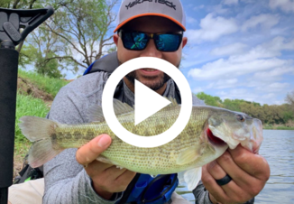 man holding Guadalupe bass, video link