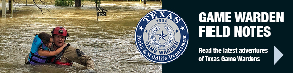 Game Warden carrying child in flood waters, link to Field Notes
