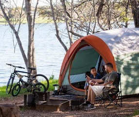 campers by lake with bikes