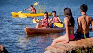 Children paddling kayaks at Inks Lake