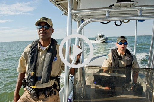 Game Wardens in Boat, video link