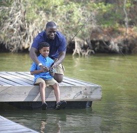man and and his son fishing on dock