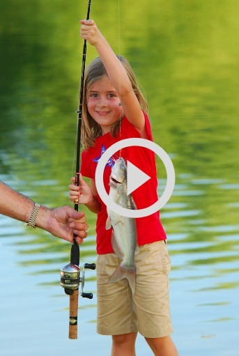 Girl holding fish, video link