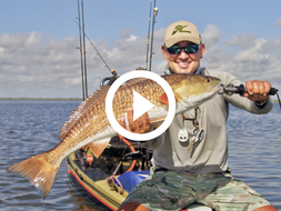 Mike Morales holding redfish, video link